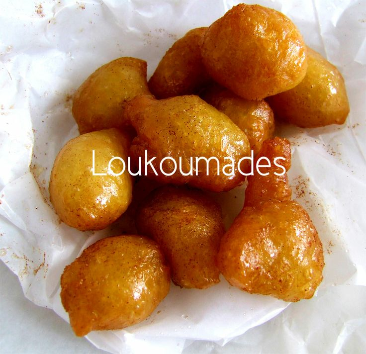 """""""Loukoumades"""", the Greek donuts or fritters, served with honey syrup and cinnamon!"""