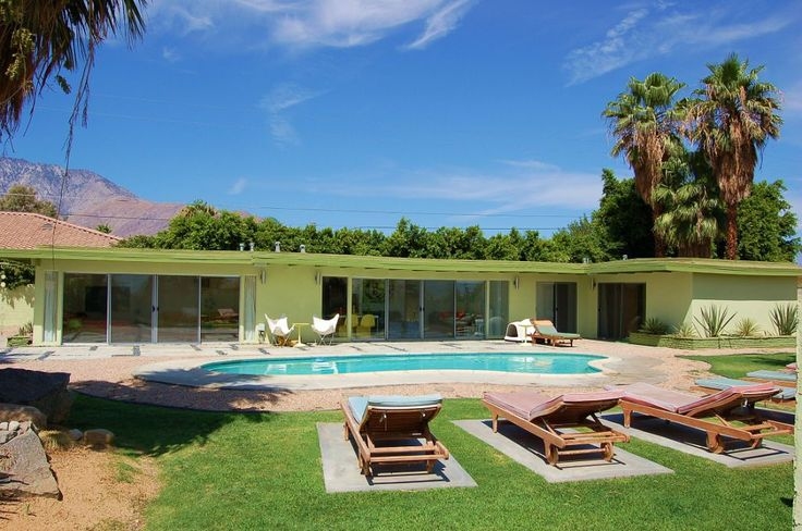 Backyard pool side at dino 39 s palm springs home 50 39 s to for New modern homes palm springs