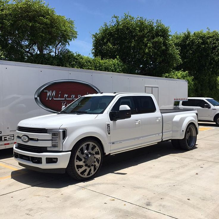 "Brand New 2017 Ford F-350 Dually. 28"" @americanforcewheels Raptor with @fueloffroad 305/30-28 tires. Lowered 3/6 front and rear, and tubbed aluminum bed for wheels. @linex.of.lauderdale took care of the liner. #mirandabuilt #2017 #f350 #dually #28's #americanforcewheels #fueltires #linex #allpainted #whiteout #aluminum #fabrication #paceedwardsbedcovers #6trumpethorn #towpig #southflorida"