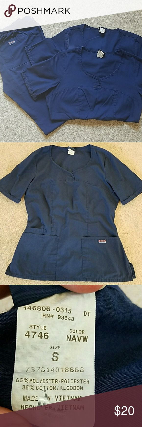 Set of Cherokee navy scrubs Set of Cherokee navy scrubs including 2 sm style 4746 tops and 1 xs tall style 4101T pants. Cherokee Tops
