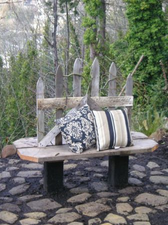 """Outside bench made from an old picket fence.  I would suggest make a small back cushion just up to the cross bar and then a seat cushion.  Can see this done in red to give it that """"WOW"""" look."""
