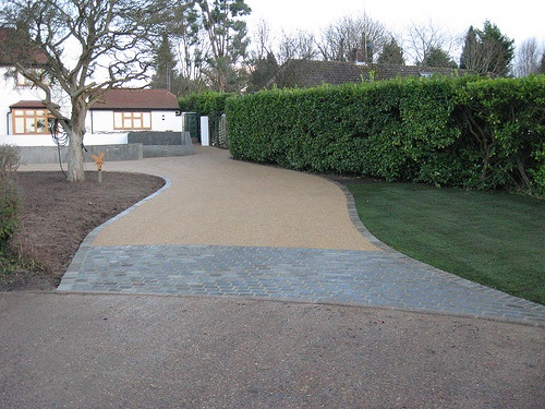 Surrey Driveway laid with RonaDeck Resin Bound Surfacing over tarmac 350 square metres, Autumn Harvest aggregate @prclandscapes
