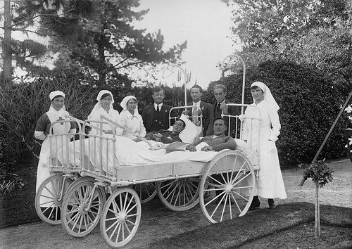 Keswick Hospital, South Australia: Two spinal cases (injured during WWI) being cared for by nurses. Some of the Keswick Hospital patients now inmates at the Anzac Hostel, Glenelg. B 26285/114.