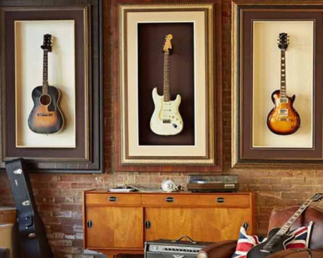 Display your guitars!! Hang the instrument directly on the wall with the appropriate instrument hanger from your local music store or take it even further with a custom frame or some fabric backing.