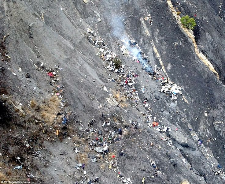 Charred wreckage was photographed on the mountainside today, where one rescue worker descr...