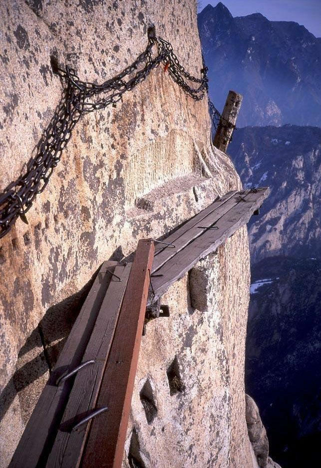 This is where the path turns truly dangerous, with nothing but planks to walk on and a rail of chains to hold onto.: