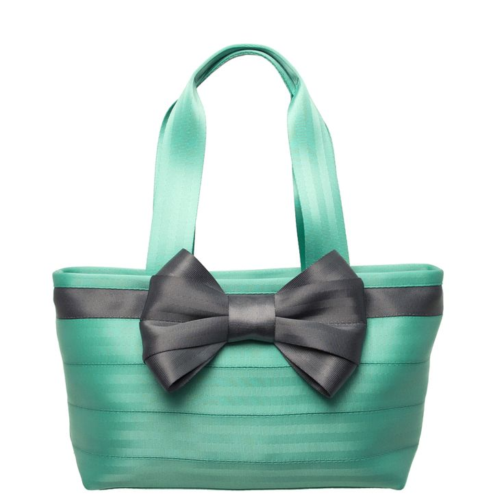 Put a bow on it! Side-by-side stitched seatbelts in light and bright Turquoise are paired with a big, beautiful bow in Storm gray for an a-BOW-able combination.