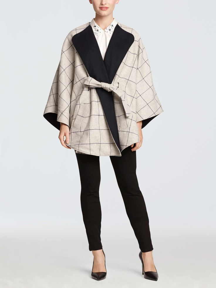 There's no easier way to look instantly chic than by throwing on a cape. Done in a menswear-inspired windowpane check, our Georgia Windowpane Cape is geniously designed with a clever belt detail that ties in front but is concealed in the back for a streamlined effect.