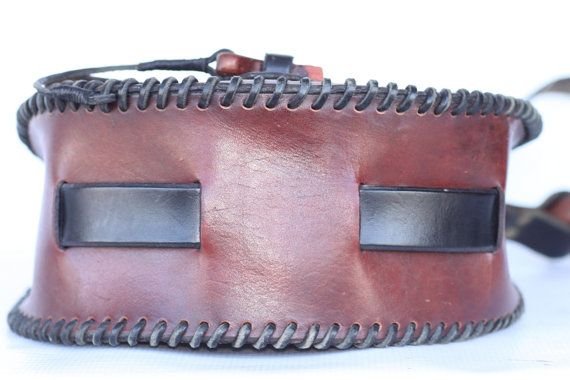 Up for your consideration, a very large and beautiful, vintage, handmade, boho leather, hippie shoulder bag with natural wood accents .    Measurements:  Length: 10 1/2  (widest point, measured from the front) Height: 11 1/2  Width: 4 1/2 (widest point from the side)  Shoulder strap drop:13  This bag is in mint condition with a wonderful vintage patina. No major damage such as holes tears or repairs. Please note, the tip of the wooden hook used to secure the flap is a little rough, its minor…