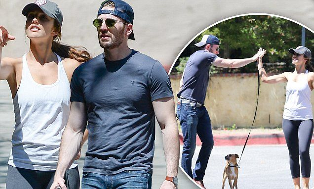 The twosome took a stroll with their dogs over Labor Day weekend and fueled rumors that their relationship might be sparking up once more.