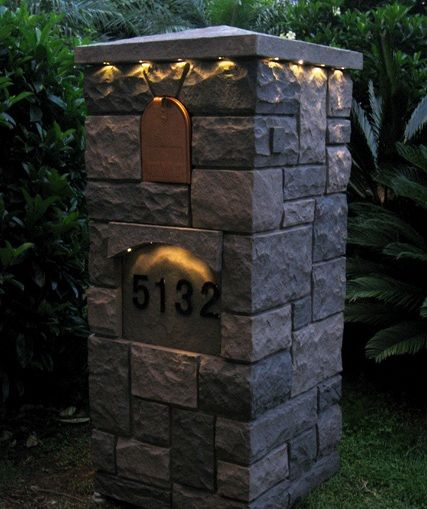 Fake stone mailbox columns come with a solar light kit under the cap.