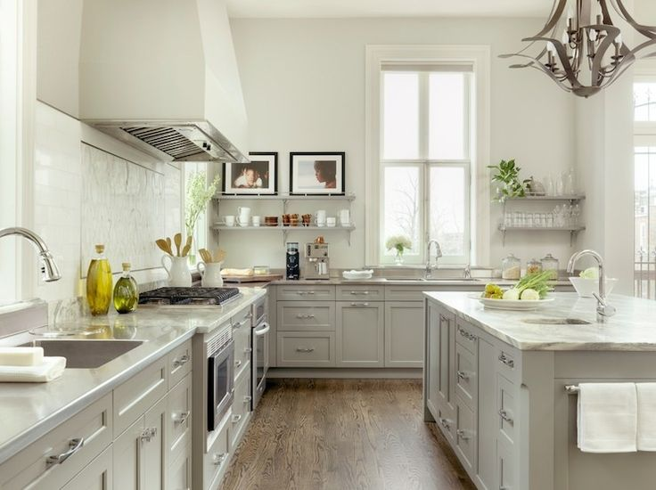 Two tone white gray kitchen floating shelves gray stone perimeter counters porters Kitchen design light grey