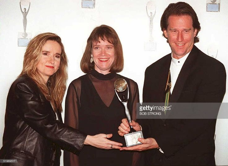 Singer Melissa Etheridge (L) and Laura and Michael Joplin (R), sister and brother of singer Janis Joplin, pose for photographers after Joplin was inducted into the Rock and Roll Hall of Fame in New York 12 January. Etheridge began her introduction by singing the late Joplin's 'Take A Little Piece of My Heart'.