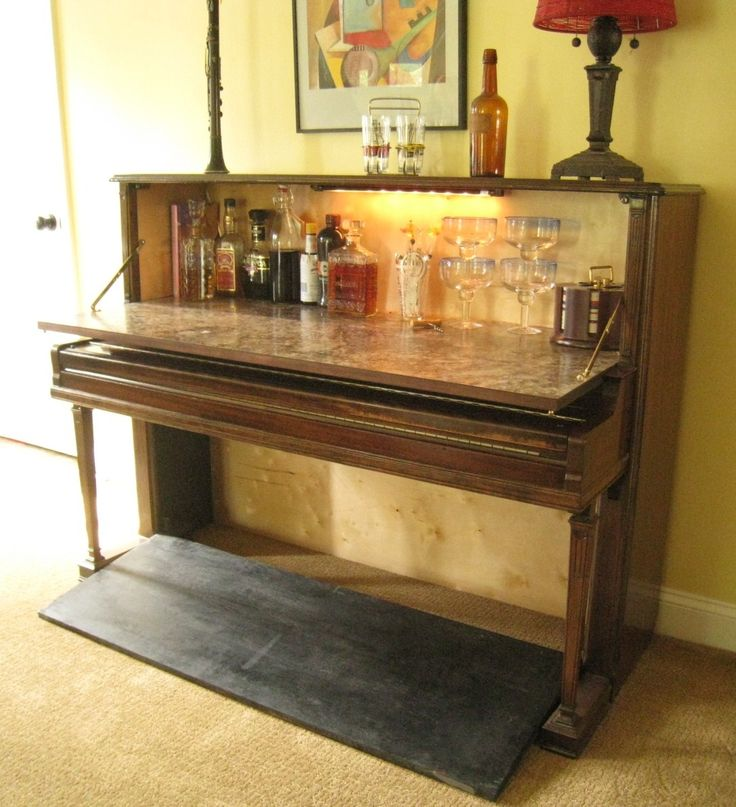 Repurposed Piano Wet Bar: The Piano Wet Bar is made from a vintage upright piano.  Open the door to reveal a lighted cabinet to house your glassware and spirits.  There is also a hidden storage space under the keyboard. This is a unique conversation piece that proves to be both useful and decorative.