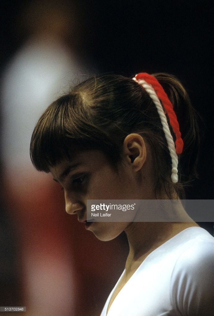 View Closeup of Romania Nadia Comaneci looking down during Women's competition…