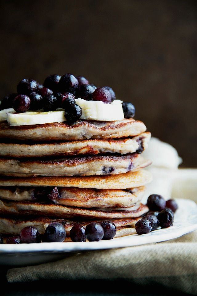These light and fluffy Blueberry Banana Greek Yogurt Pancakes are sure to keep you satisfied all morning with over 20g of whole food protein! | runningwithspoons.com #glutenfree #healthy #breakfast