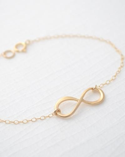 Olive Yew for JEWELMINT COLLECTIVESmall gold infinity bracelet. Measures 7 inches on a shiny, petite gold filled chain. Infinity charm measures just 1 inch.7 inch gold filled bracelet... More Details