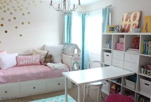 girls bedroom in benjamin moore pink bliss with chandelier, ikea hemnes bed and kallax bookshelf. Great organizing ideas with fun accent colours. Beautiful nursery palette as well