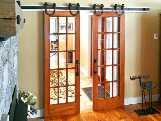 Interior barn door kit with glass panel interior barn door for Sliding panel doors interior