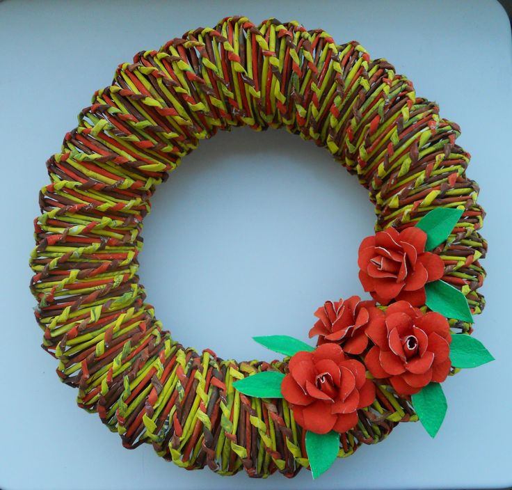 This wreath is made from newspaper.  Roses are made from toilet paper rolls: http://www.askarteluideoita.fi/askartelu/kukkia-eri-materiaaleista/