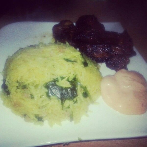 Yellow rice with colard greens and steak