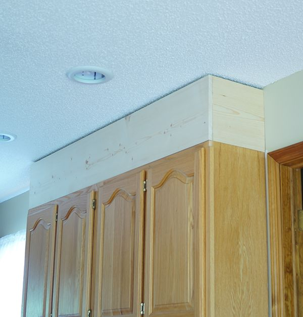 Diy painting laminate cabinets diy kitchen cabinet for Adding crown molding to existing kitchen cabinets