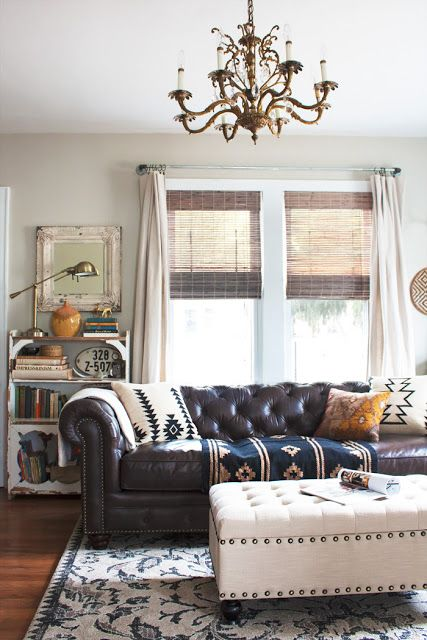 this is more eclectic than you like, but see how the pillows and light ottoman lighten things up?