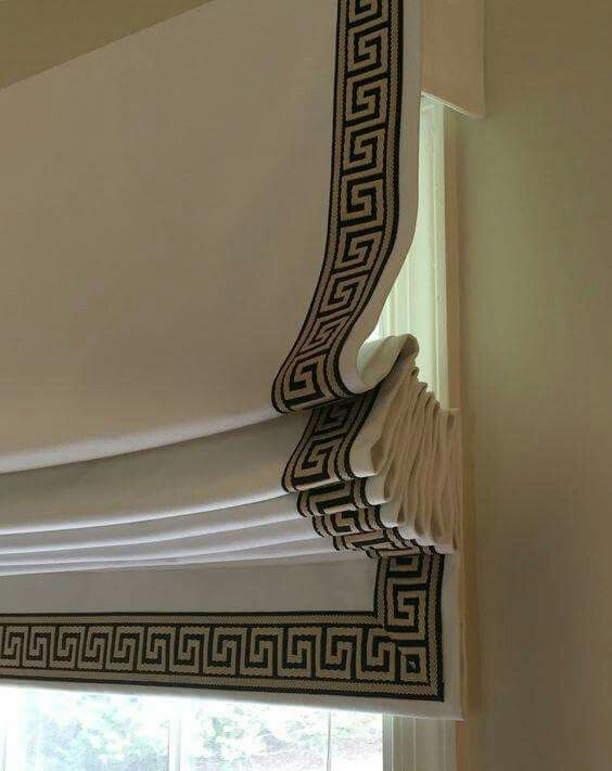 Beige Roman blind with geometric black trim.