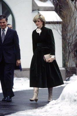 February 12, 1984: Princess Diana receives a posy from a child at the British Embassy during her visit to Oslo, Norway.