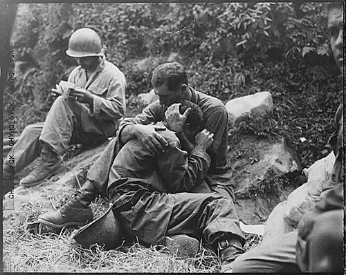 Could this be a Dear John? (see letter on the ground, next to the sobbing soldier's leg and the soldier next to them, also reading mail)
