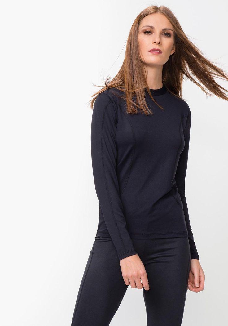 Camiseta interior lisa de mujer para esquiar con cuello redondo cerrado. Diseñado en España.Poliamida 94% Elastano 6%