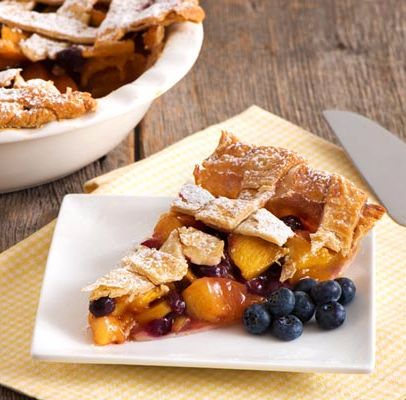 Peach Blueberry Pie-Classic lattice pie bursting with summer fruit flavors. Since peaches are already sweet, Chef Eddy reduced the amount of sugar by half in this refreshing summer pie. Picture the olden days with this beautiful dessert cooling off on mom's window sill as you count down the minutes until dinner time! This sweet treat is perfect for just about any special occasion or party with friends and family....birthday party, anniversary dinner, potluck social, neighborhood block party…