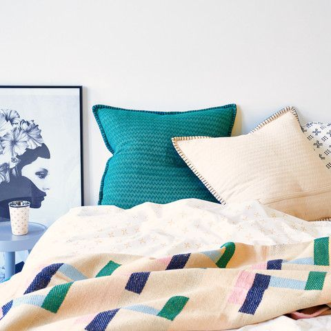 Reversible blanket stitch cushion with chevron pattern