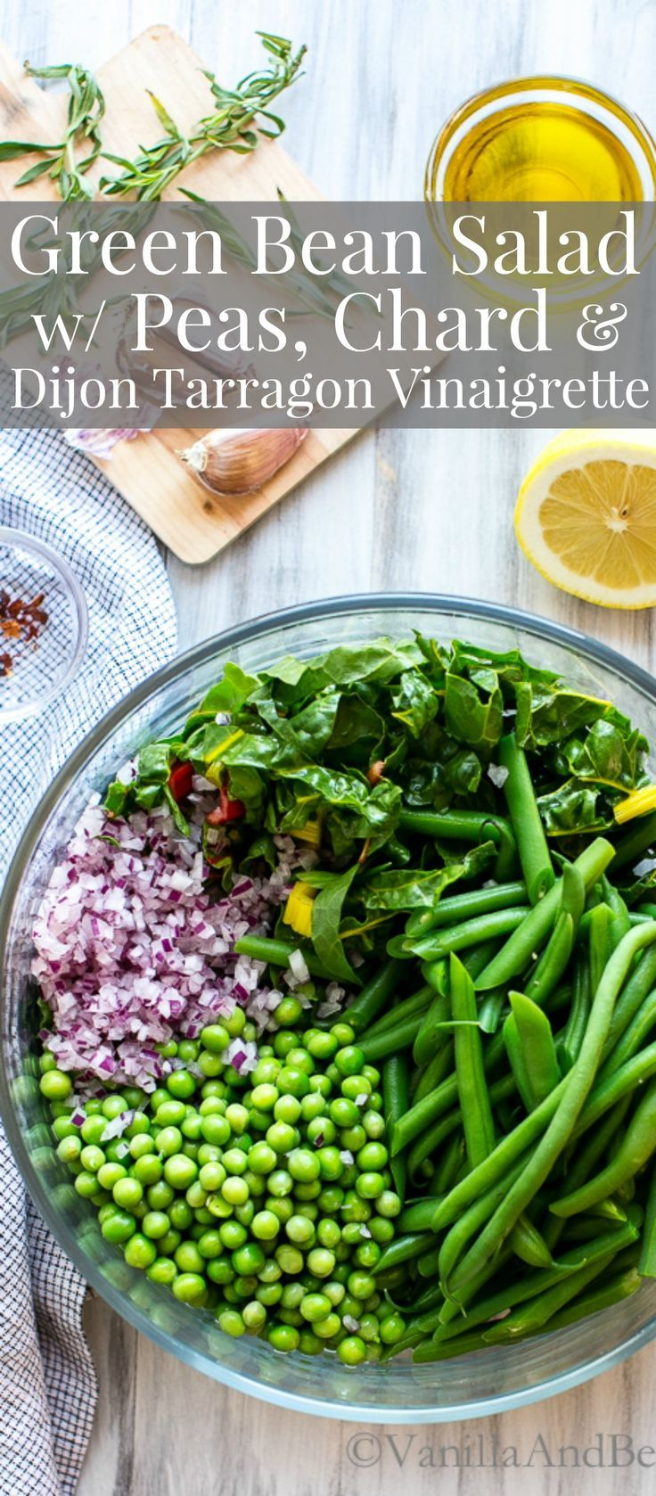 A Summertime salad with the freshest market veggies. We've eaten this salad as a main course, but it can be a star side or fabulous starter. Green Bean Salad with Peas, Chard and Dijon Tarragon Vinaigrette is snappy and oh so fresh! Vegan + gluten free | Recipes | Vegetarian