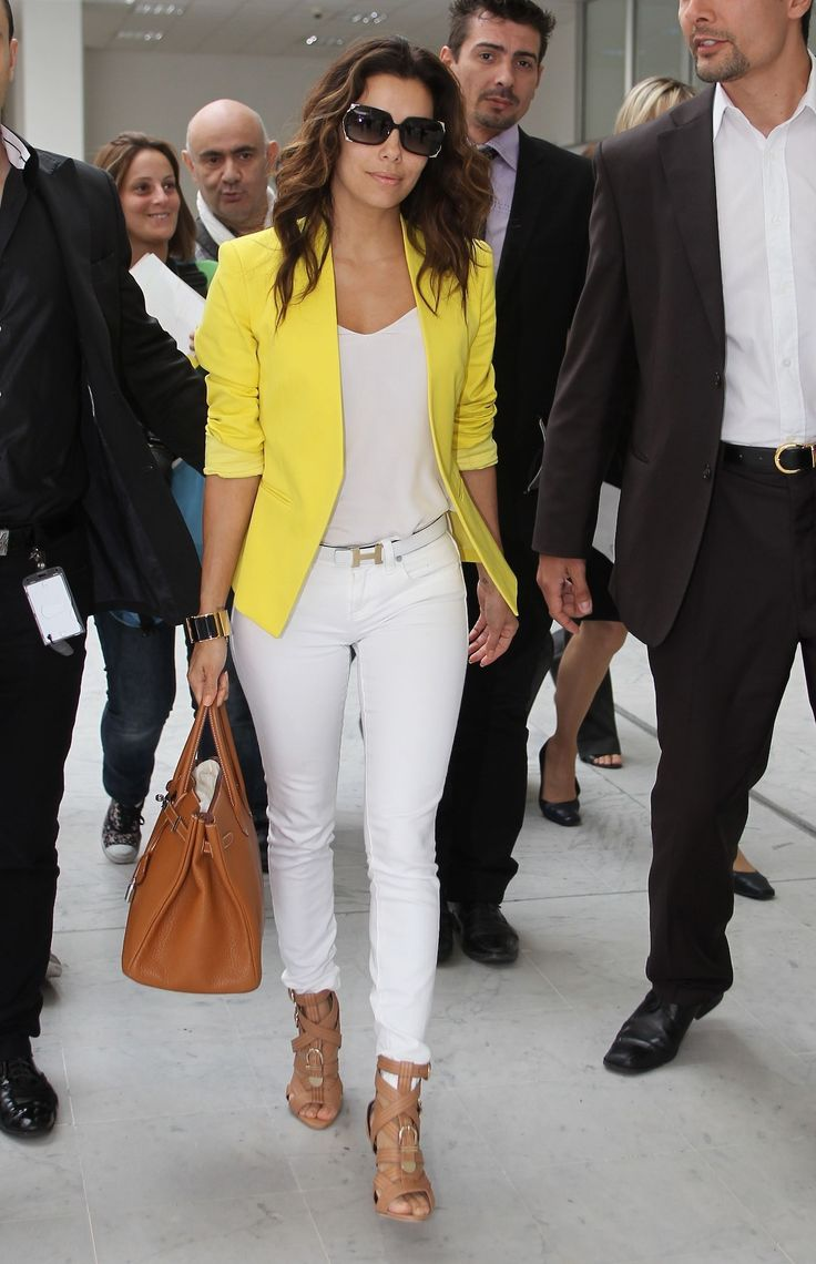 White pants and top. Bright yellow blazer. Brown bag and shoes