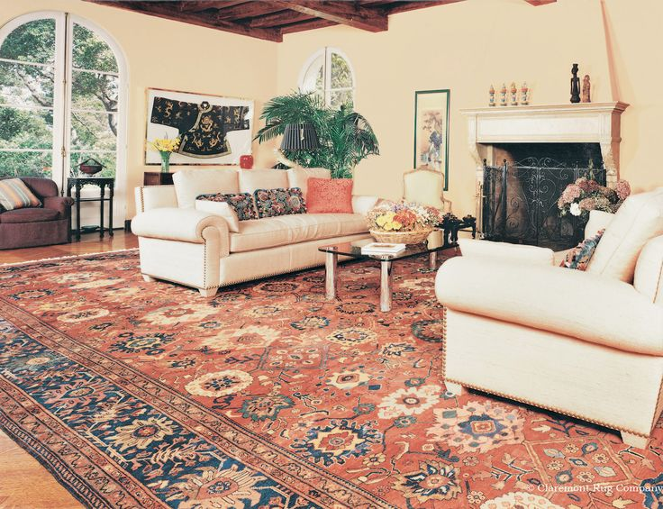 19th Century Sultanabad Antique Rug Unifies This Living Room And Art Collection