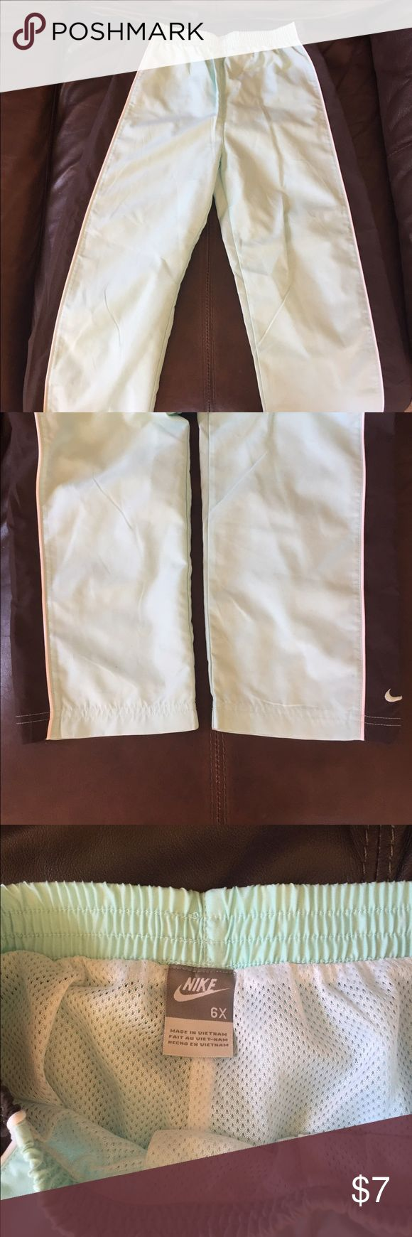 Girl Nike Running pants Girl NWOT Nike running pants in a light blue and brown. Fully lined in the mesh material shown in the 3rd picture. My daughter outgrew them before she could wear them. Perfect condition! Nike Bottoms Sweatpants & Joggers