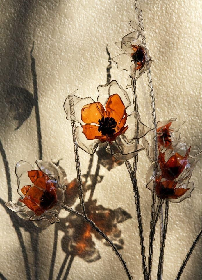 Flowers ---  Recycled plastic bottles (melted) via Talented artist Facebook.com/GalinaBarskaya
