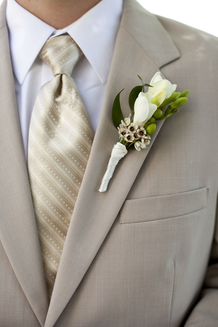 The groom is wearing the Tan Rapture Suit from http://www.mytuxedocatalog.com/tuxedos/C981-Tan-Rapture-Suit/!