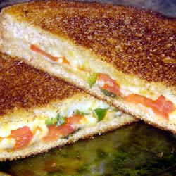Grilled Cheese with Tomato, Peppers and Basil recipe But imagine mozzarella cheese, basil, salt and pepper, and tomatoes!