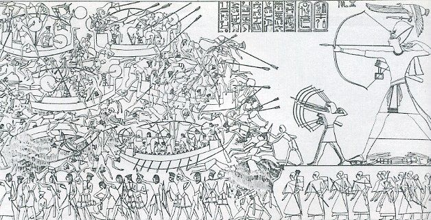 """Emmanuel de Rougé's translation of the North wall of the mortuary temple of Ramesses III at Medinet Habu led him to coin the term """"Sea Peoples."""" This famous scene shows what has come to be known as the Battle of the Delta in 1177 BC. (The original uploader was Seebeer at German Wikipedia in 2006. This image is in the public domain because its copyright has expired.)"""