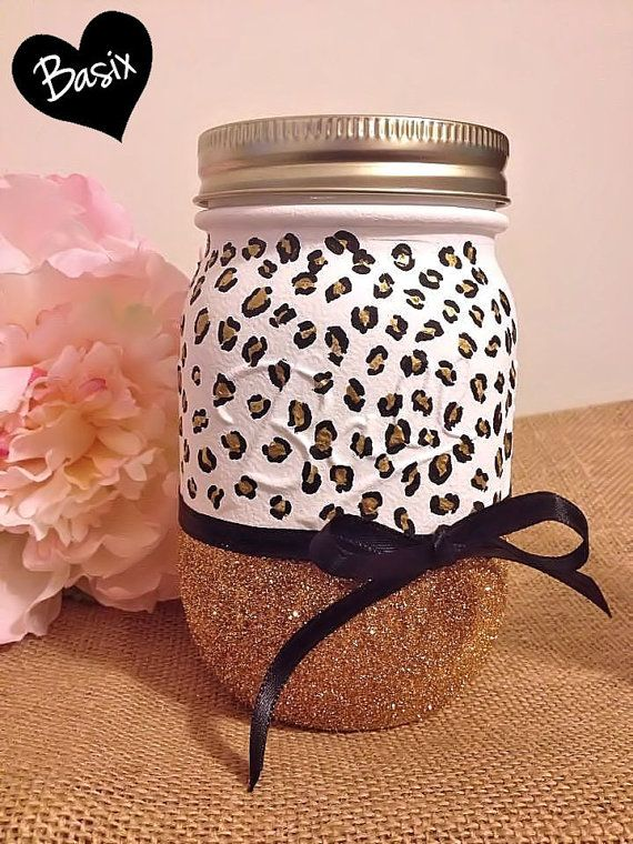 Painted animal print mason jar with glitter.  Cute way to display flowers, or keep things organized, (think bathroom, kitchen, desk).  This would make a great, unique gift!