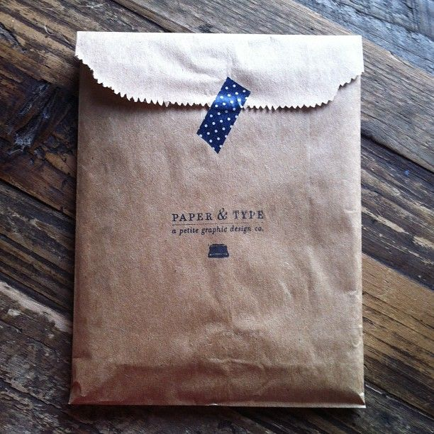 Brown paper bag with washi tape and personalised stamp. Instead of an envelope.