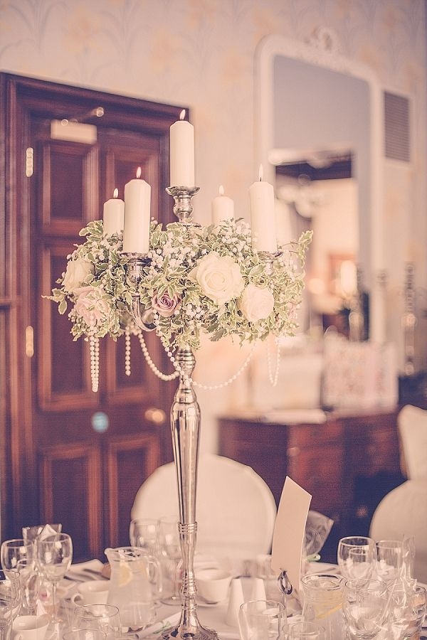 wroxall abbey wedding flowers vintage glamour candelabra with pearls centrepiece. See more of our floral designs at www.passionforflowers.net. Voted Best Wedding Florist in ENGLAND in The Wedding Industry Awards.