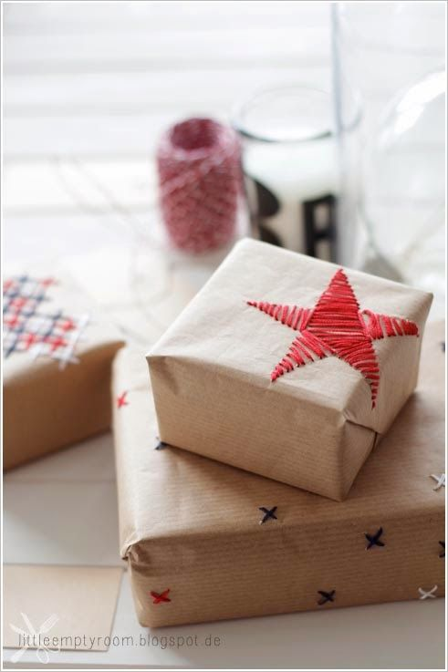 Stitched gift wrap adds texture and three-dimensionality. All you need is kraft paper, a needle, and some embroidery thread.
