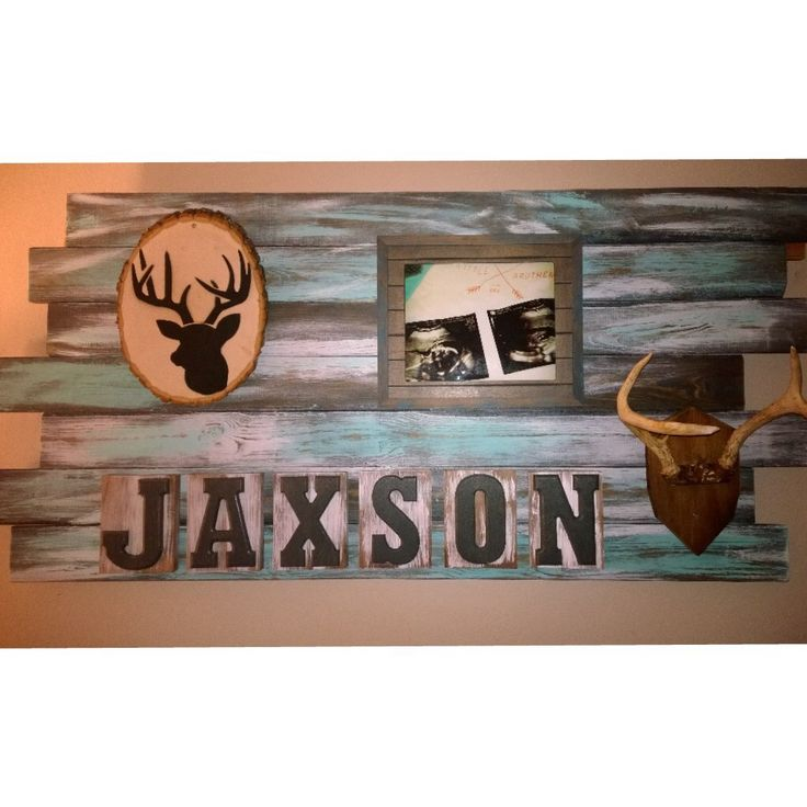 DIY name board for a rustic hunting themed nursery. Deer and antlers. Adorable