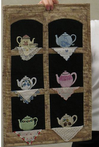 hankie embellished quilt thingie..would also be pretty with tea cup motif