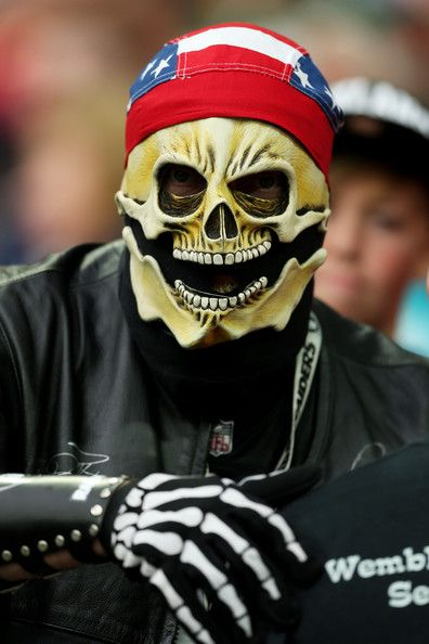 Raiders fans show their support during the NFL match between the Oakland Raiders and the Miami Dolphins at Wembley Stadium on September 28, 2014 in London, England.