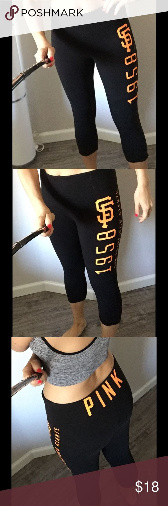 "Victoria's Secret PINK SF Giants capri legging MED Style no longer available! From the exclusive Victoria's Secret pink MLB collection/ with 5th and Ocean.  Black cotton/elastane legging size medium runs true to size.  I love the high rise, thick waistband.  Flourescent orange SF 1875 San Francisco Giants printed on left thigh, and PINK on back waistband.  Medium- About 27"" long - perfect condition, no cracks in print.  Retailed for $50 - purchased at SF store. Pants"