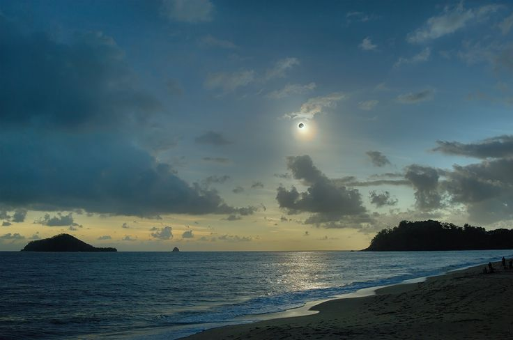 Like a Diamond in the Sky: Streaming past the Moon's edge, the last direct rays of sunlight produced a gorgeous diamond ring effect in this scene from Ellis Beach between Cairns and Port Douglas, QLD Australia during Wednesday's eclipse